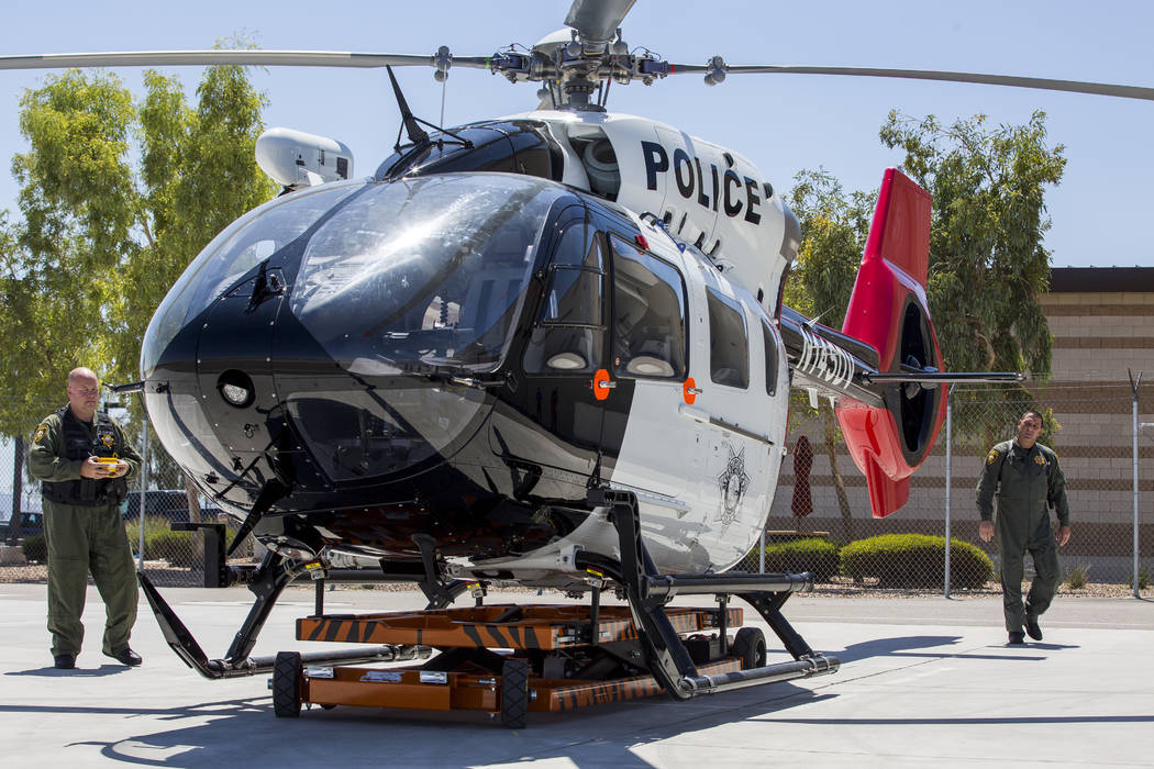 Chief Pilot Steve Morris Jr., right,  and pilot Bryan Woolard bring out the new Las Vegas police helicopter for flight at the North Las Vegas Airport on Aug. 16, 2017. (Patrick Connolly/Las Vegas  ...