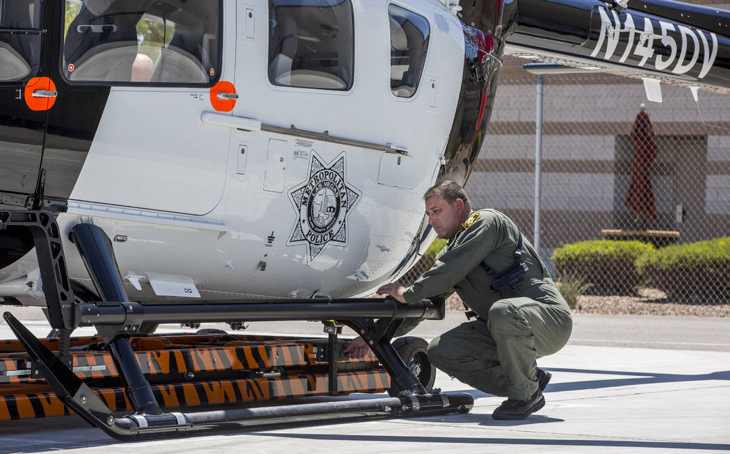 Chief Pilot Steve Morris Jr. prepares the new Las Vegas police helicopter for flight at the North Las Vegas Airport on Aug. 16, 2017. (Patrick Connolly/Las Vegas Review-Journal)  @PConnPie