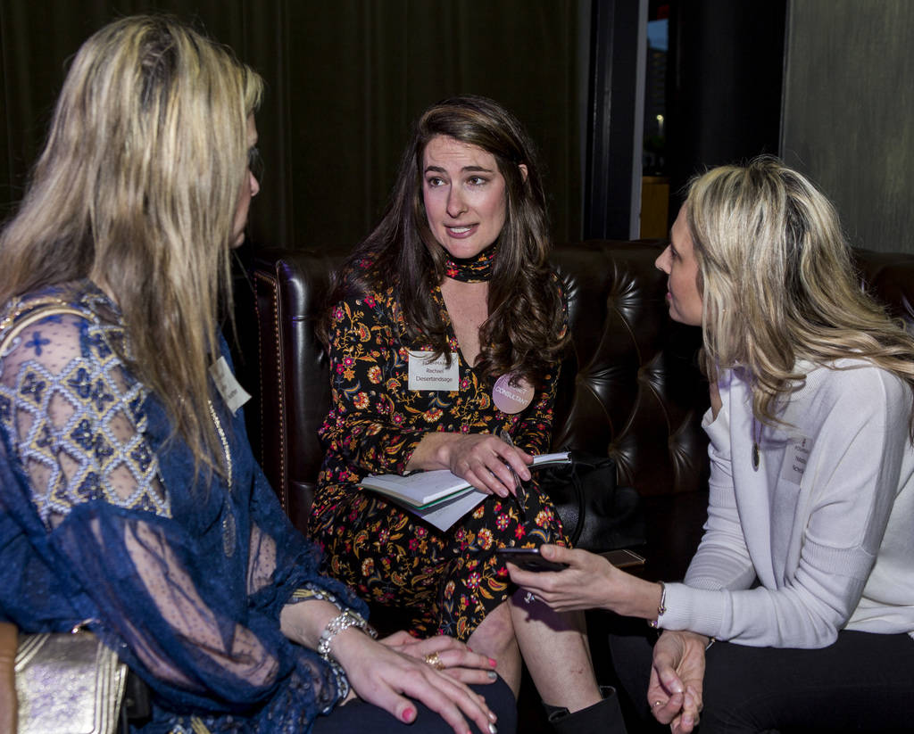 Rachel, center, a closet consultant, helps Heather Nicole, left, and Natasha Ncheckov, right, with their closets at a Posh Party LIVE event at SLS Las Vegas on Tuesday, March 20, 2018.  Patrick Co ...