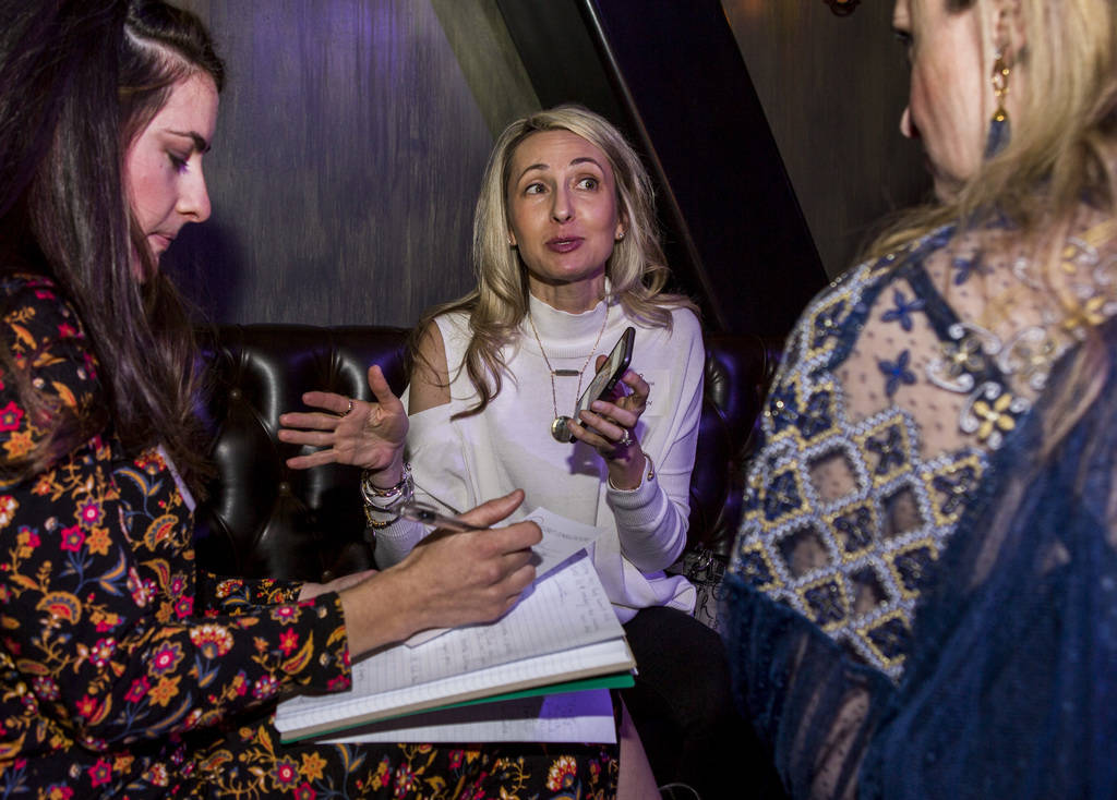 Natasha Ncheckov, center, talks about her closet with Rachel, left, a closet consultant, and Heather Nicole, right, at a Posh Party LIVE event at SLS Las Vegas on Tuesday, March 20, 2018.  Patrick ...