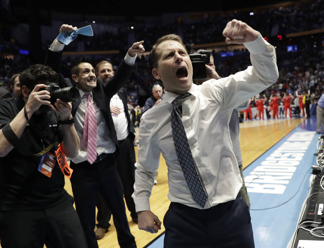 Nevada head coach Eric Musselman celebrates as his team defeated Cincinnati during a second-round game in the NCAA college basketball tournament in Nashville, Tenn., Sunday, March 18, 2018. Nevada ...
