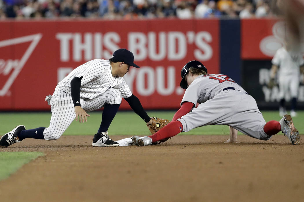 Boston Red Sox's Brock Holt (12) steals second base as New York Yankees second baseman Ronald Torreyes, left, attempts to tag him out during the fifth inning of a baseball game Sunday, Aug. 13, 20 ...