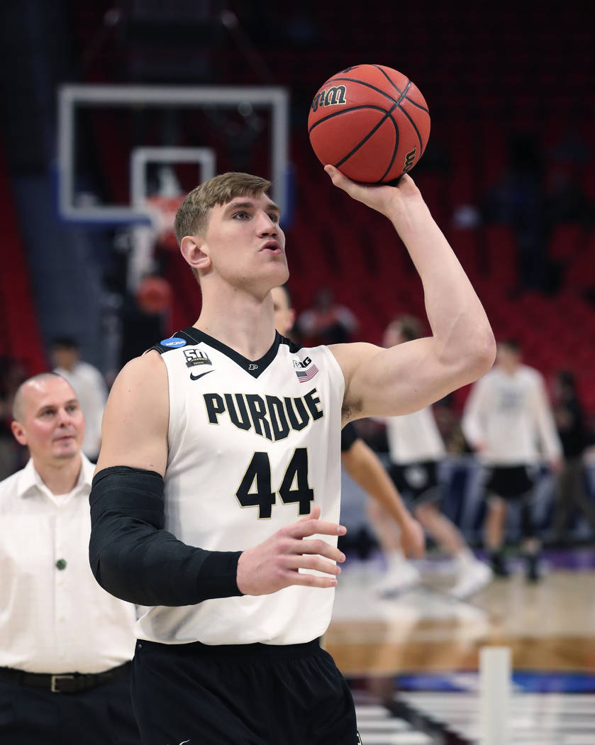 Purdue center Isaac Haas shoots during warmups before a second round game against Butler in the NCAA college basketball tournament, Sunday, March 18, 2018, in Detroit. A day after Isaac Haas' seas ...