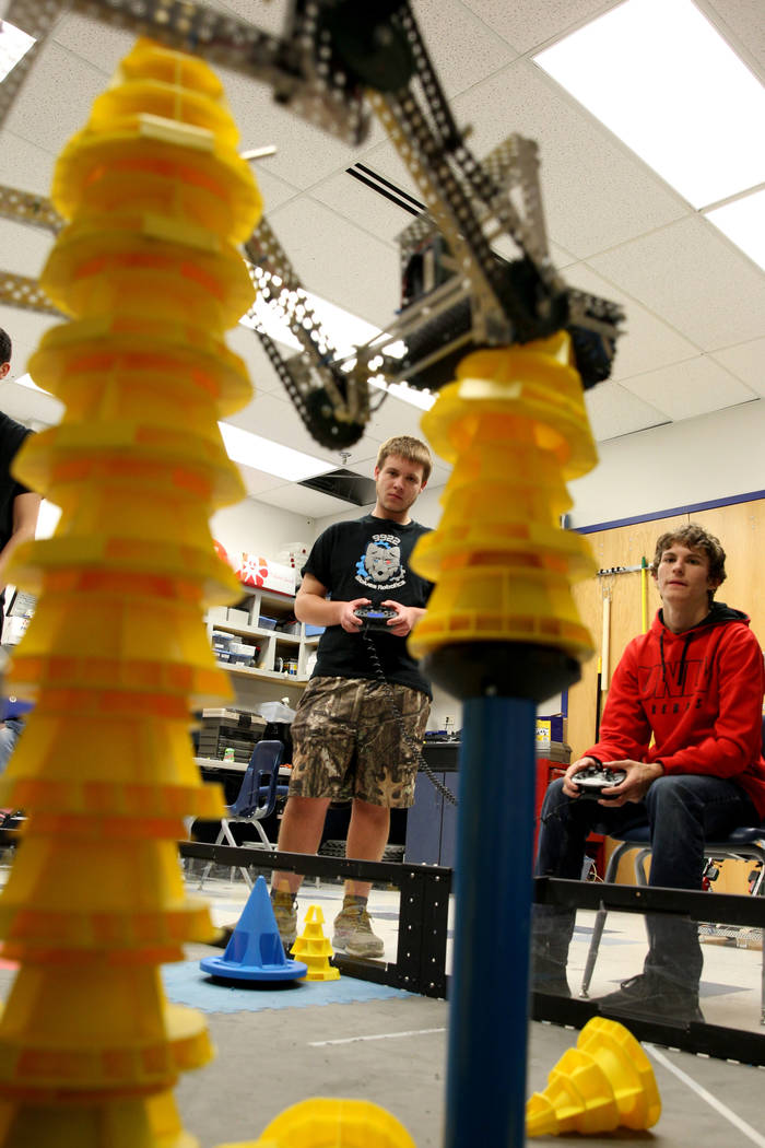 Lenny Montalbano, right, and his partner C.D. Perkins operate their robot to stack cones during Robot Club at Basic Academy of International Studies in Henderson Wednesday, March 21, 2018. The clu ...