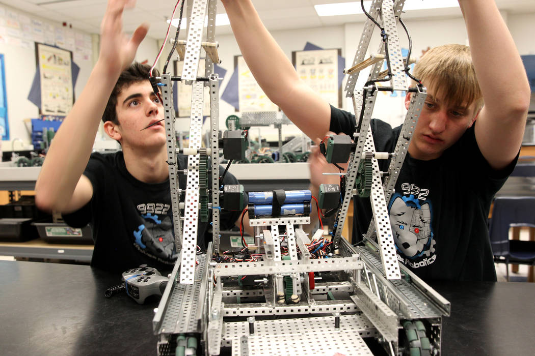 Basic Academy of International Studies senior Matteo Cipriani, left, and junior Tenton Moon work on their robot during Robot Club at the Henderson school Wednesday, March 21, 2018. The club is pre ...