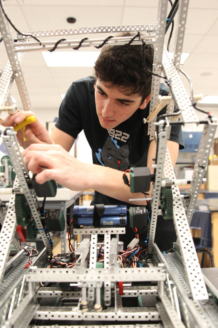 Basic Academy of International Studies senior Matteo Cipriani works on his robot during Robot Club at the Henderson school Wednesday, March 21, 2018. The club is preparing for the U.S. Open Roboti ...