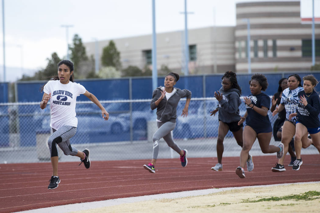 Dayvian Diaz, 18, left, during a track practice at Shadow Ridge High School in Las Vegas, Wednesday, March 21, 2018. Erik Verduzco Las Vegas Review-Journal @Erik_Verduzco