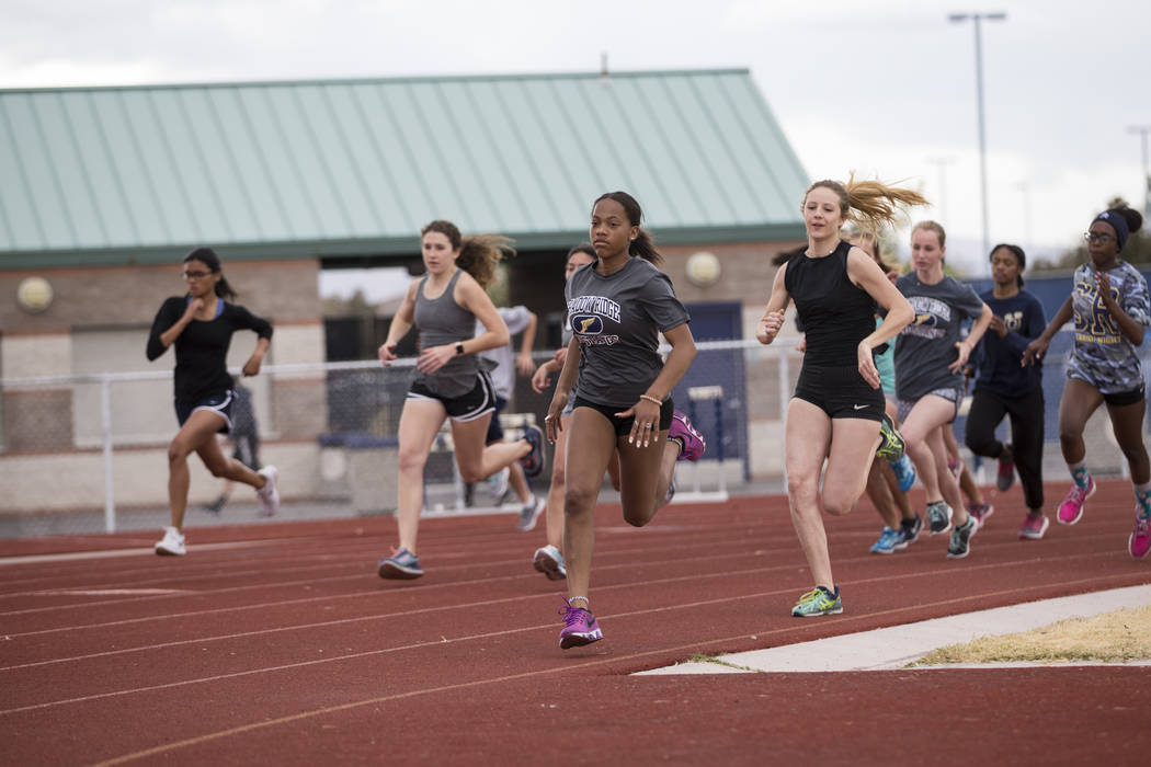 Jordan Ford, 17, center, during a track practice at Shadow Ridge High School in Las Vegas, Wednesday, March 21, 2018. Erik Verduzco Las Vegas Review-Journal @Erik_Verduzco