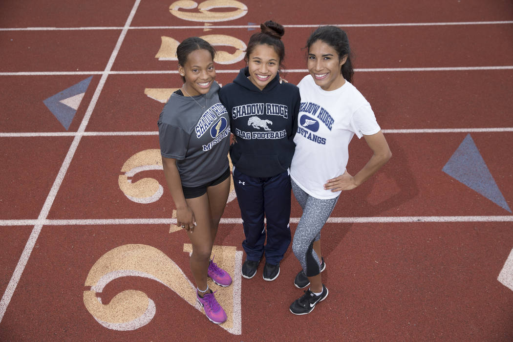 Jordan Ford, 17, from left, Vanessa Almanzor, 17, and Dayvian Diaz, 18, during a track practice at Shadow Ridge High School in Las Vegas, Wednesday, March 21, 2018. Erik Verduzco Las Vegas Review- ...