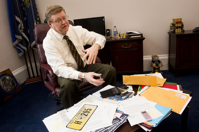 In his Capitol Hill office on Tuesday, Rep. Mark Amodei, R-Nev., displays the lapel pin, license plate and other items given to members of Congress before a new session. (Lisa Helfert/ Stephens Media)