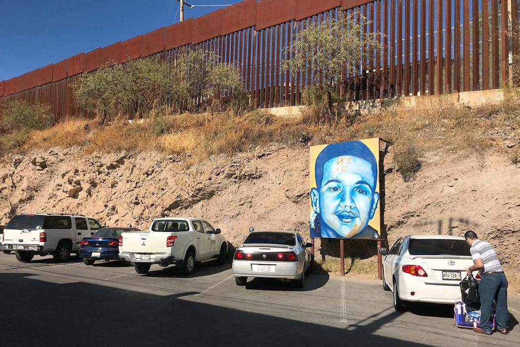 A portrait of 16-year-old Mexican youth Jose Antonio Elena Rodriguez, who was shot and killed in Nogales, Sonora, Mexico, is displayed on Dec. 4, 2017, on the street where he was killed more than  ...