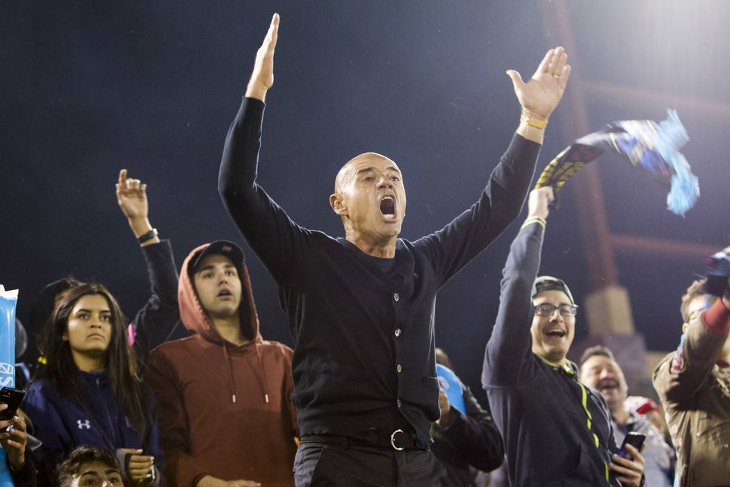 Las Vegas Lights FC head coach Jose Luis Sanchez Sola in the bleachers with fans after getting ejected from the game against the Vancouver Whitecaps FC at Cashman Field in Las Vegas, Saturday, F ...
