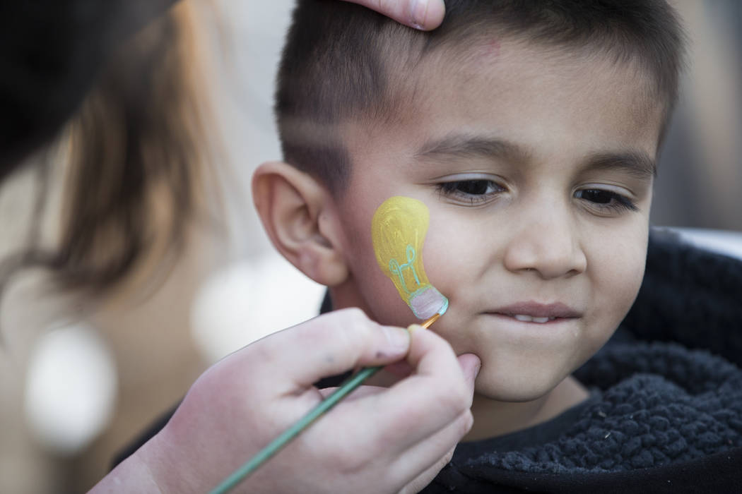 Adrian Pineda, 4, gets his face painted before the United Soccer League season home opener game for the Las Vegas Lights FC at Cashman Field in Las Vegas, Saturday, March 24, 2018. Erik Verduzco L ...