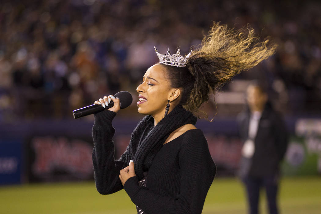 Miss Nevada Andrea Martinez signs the national anthem during the United Soccer League season home opener for the Las Vegas Lights FC against Reno 1868 FC at Cashman Field in Las Vegas, Saturday, M ...