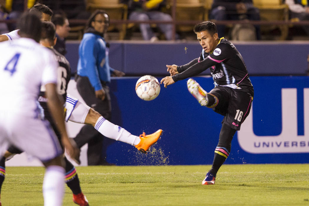 Las Vegas Lights FC's Marcelo Alatorre (16) kicks a pass against Reno 1868 FC during the first half of the United Soccer League game at Cashman Field in Las Vegas, Saturday, March 24, 2018. ...