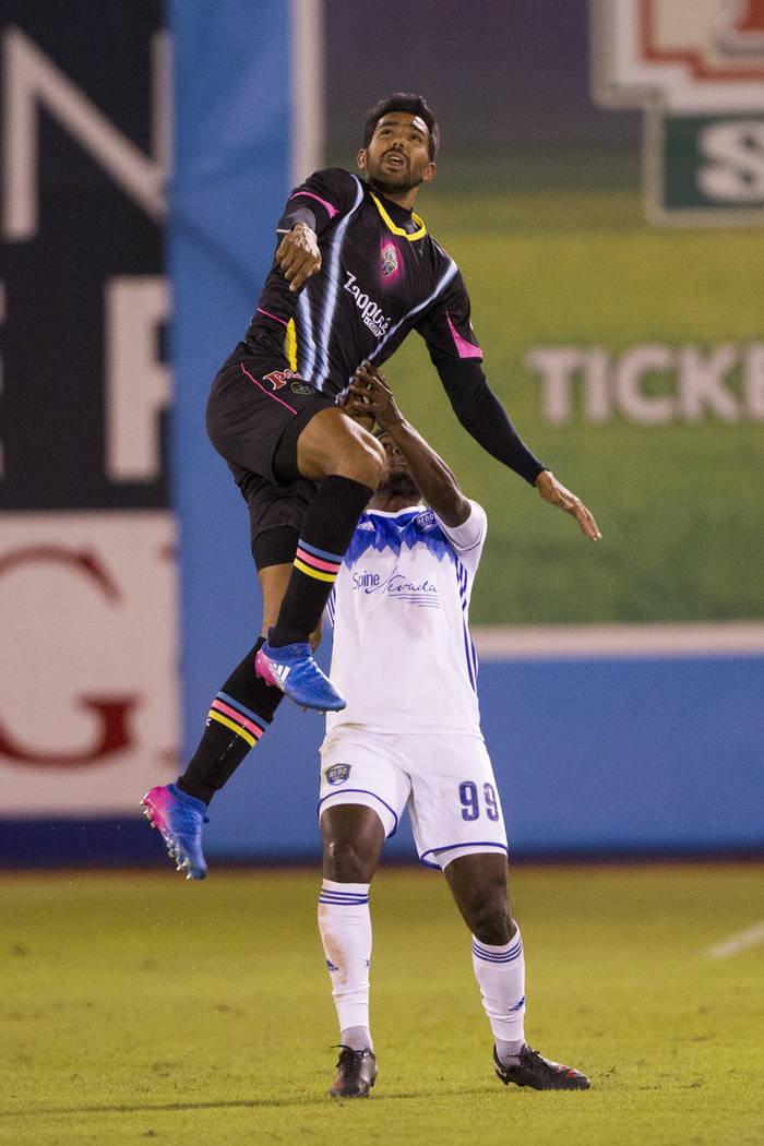 Las Vegas Lights FC's  Miguel Angel Gardun~o (33) goes up for the ball against Reno 1868 FC's Brian Brown (99) during the first half of the United Soccer League game at Cashman Field ...