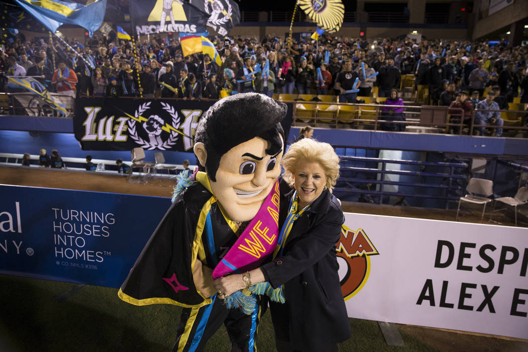 Las Vegas Mayor Carolyn Goodman with Las Vegas Lights FC mascot Cash the Soccer Rocker during the United Soccer League home opener game against Reno 1868 FC at Cashman Field in Las Vegas, Saturday ...