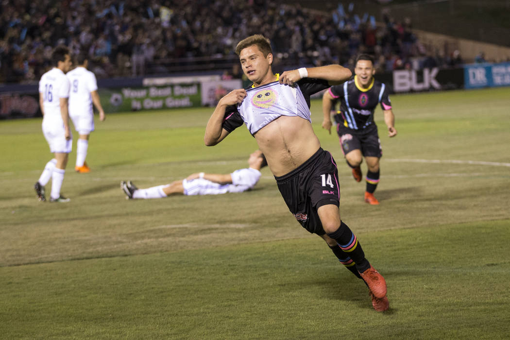 Las Vegas Lights FC's Alex Mendoza (14) celebrates his goal against Reno 1868 FC in the first half of the United Soccer League game at Cashman Field in Las Vegas, Saturday, March 24, 2018.  ...