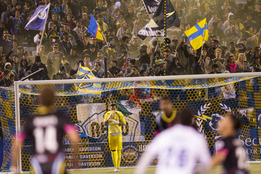 Las Vegas Lights FC fans cheer for their team against Reno 1868 FC during the second half of the United Soccer League game at Cashman Field in Las Vegas, Saturday, March 24, 2018. The game ended i ...