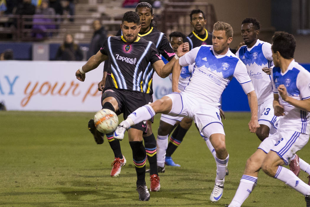 Las Vegas Lights FC's Marco Cesar Jaime Jr. (6), left, and Reno 1868 FC's Guy Abend (8) go for the ball during the second half of the United Soccer League game at Cashman Field in La ...