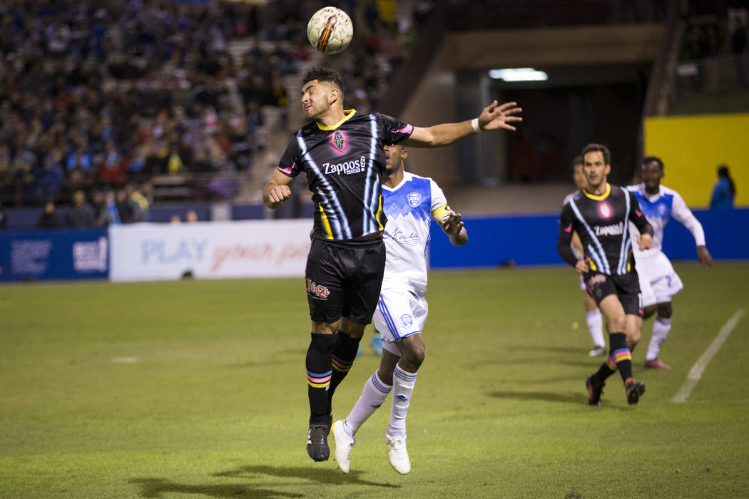 Las Vegas Lights FC's Marco Cesar Jaime Jr. (6) goes for the ball against Reno 1868 FC during the second half of the United Soccer League game at Cashman Field in Las Vegas, Saturday, March ...