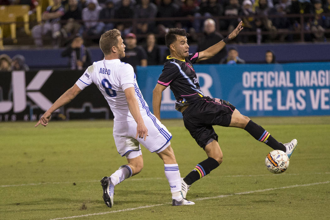 Las Vegas Lights FC's Carlos Alvarez (7) goes for the ball against Reno 1868 FC's Guy Abend (8) during the second half of the United Soccer League game at Cashman Field in Las Vegas, ...