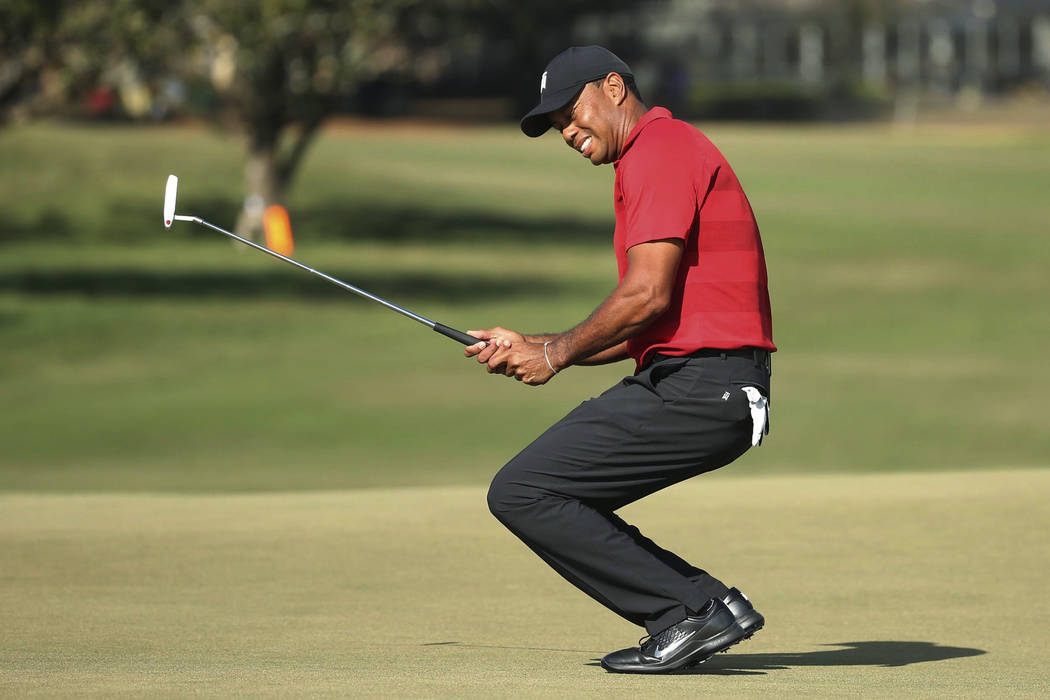 Tiger Woods grimaces after missing a putt on the 15th green during the final round of the Arnold Palmer Invitational golf tournament Sunday, March 18, 2018, in Orlando, Fla. (Stephen M. Dowell/Orl ...