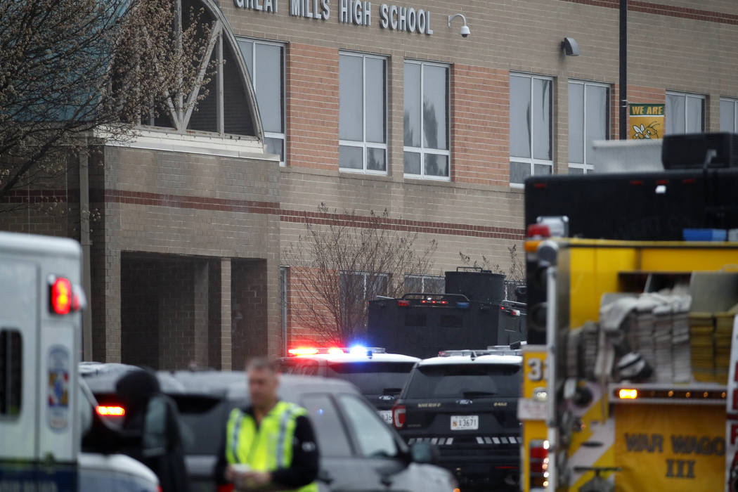 Deputies and federal agents converge on Great Mills High School, the scene of a shooting, Tuesday morning, March 20, 2018 in Great Mills, Md. The shooting left at least three people injured includ ...