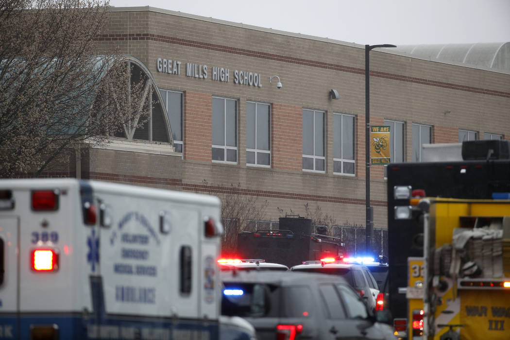 Deputies, federal agents and rescue personnel, converge on Great Mills High School, the scene of a shooting, Tuesday morning, March 20, 2018 in Great Mills, Md. The shooting left at least three pe ...