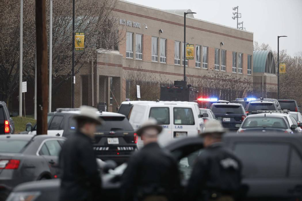 Deputies and federal agents converge on Great Mills High School, the scene of a shooting, Tuesday morning, March 20, 2018 in Great Mills, Maryland. The shooting left three people injured including ...