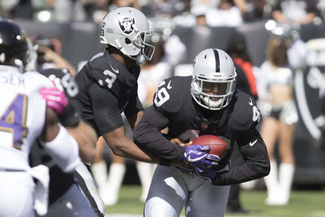 Oakland Raiders fullback Jamize Olawale (49) carries the football against the Baltimore Ravens in the first half of their game in Oakland, Calif., Sunday, Oct. 8, 2017. (Heidi Fang/Las Vegas Revie ...