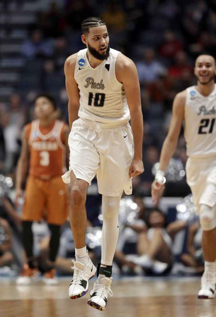 Nevada forward Caleb Martin (10) reacts after sinking a basket in overtime of a first-round game against Texas in the NCAA college basketball tournament in Nashville, Tenn., Friday, March 16, 2018 ...