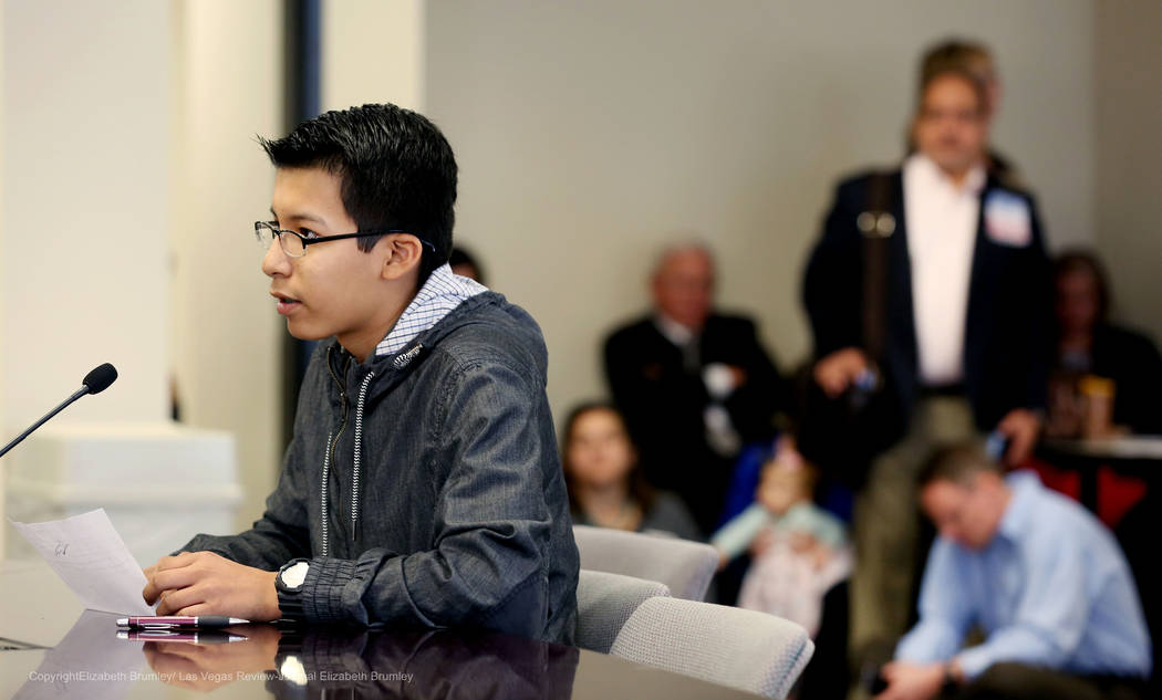 Erick Ruiz, a ninth grade student at Odyssey Charter High School, shares his opinion against transgender policies for the Clark County School District at  Nevada Department of Education in Las Veg ...