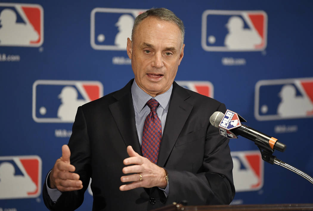 In this Thursday, Feb. 1, 2018, file photo, Major League Baseball Commissioner Rob Manfred speaks during a news conference at the baseball owners meetings in the Four Seasons Hotel, in Los Angeles ...