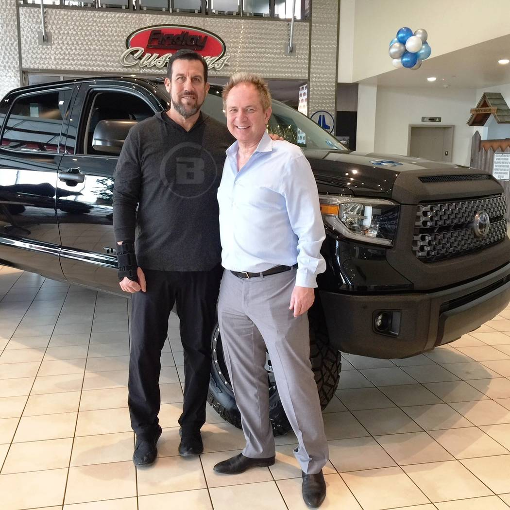 "Findlay Mixed Martial Arts referee ""Big John"" McCarthy, left, who owns a 2015 Tundra, made an appearance at Findlay Toyota on March 10. He and dealership General Manager John Barr are seen wit ..."