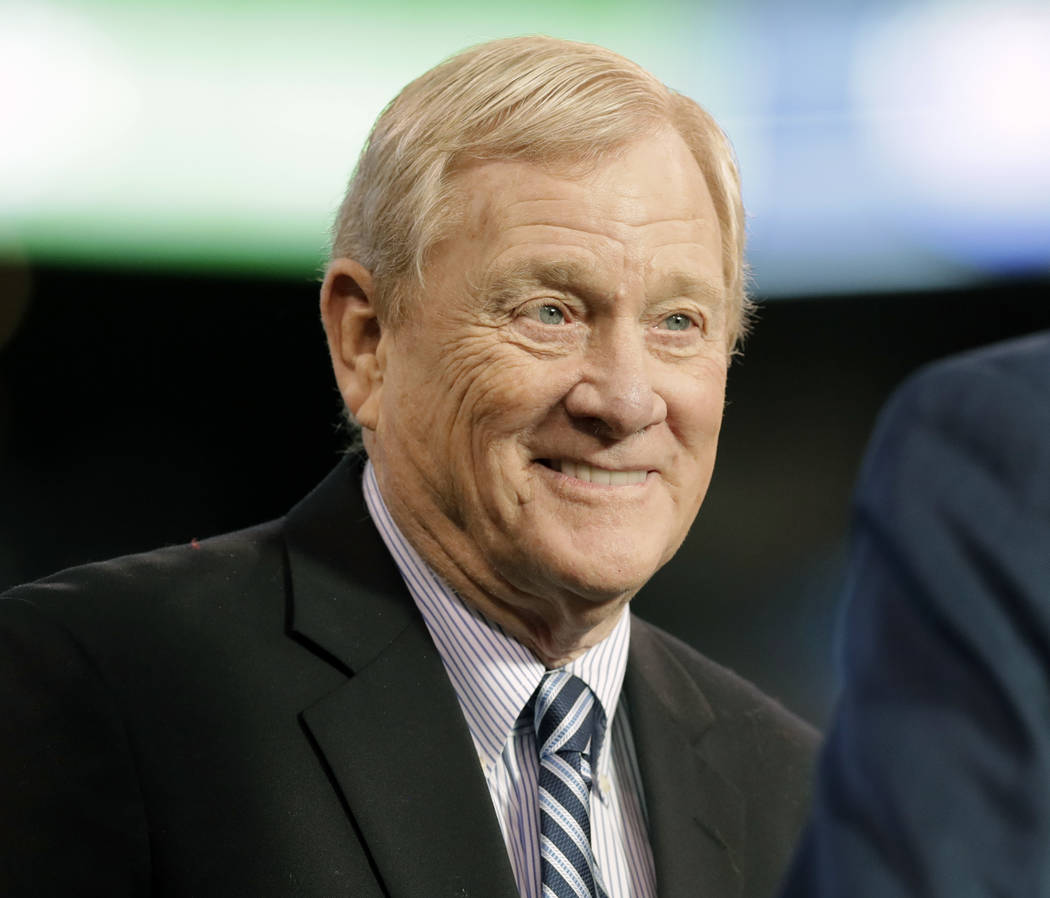 In this Jan. 1, 2017, file photo, former Indianapolis Colts general manager Bill Polian smiles as he's inducted into the team's Ring of Honor during halftime of an NFL football game in Indianapoli ...