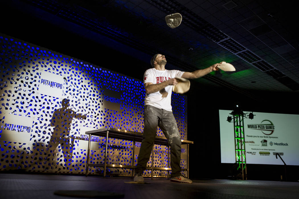 Jerome Falcojuggles pizza doughs during the freestyle acrobatic dough tossing event of the World Pizza Games at the Las Vegas Convention Center in Las Vegas, Wednesday, March 21, 2018. Patri ...