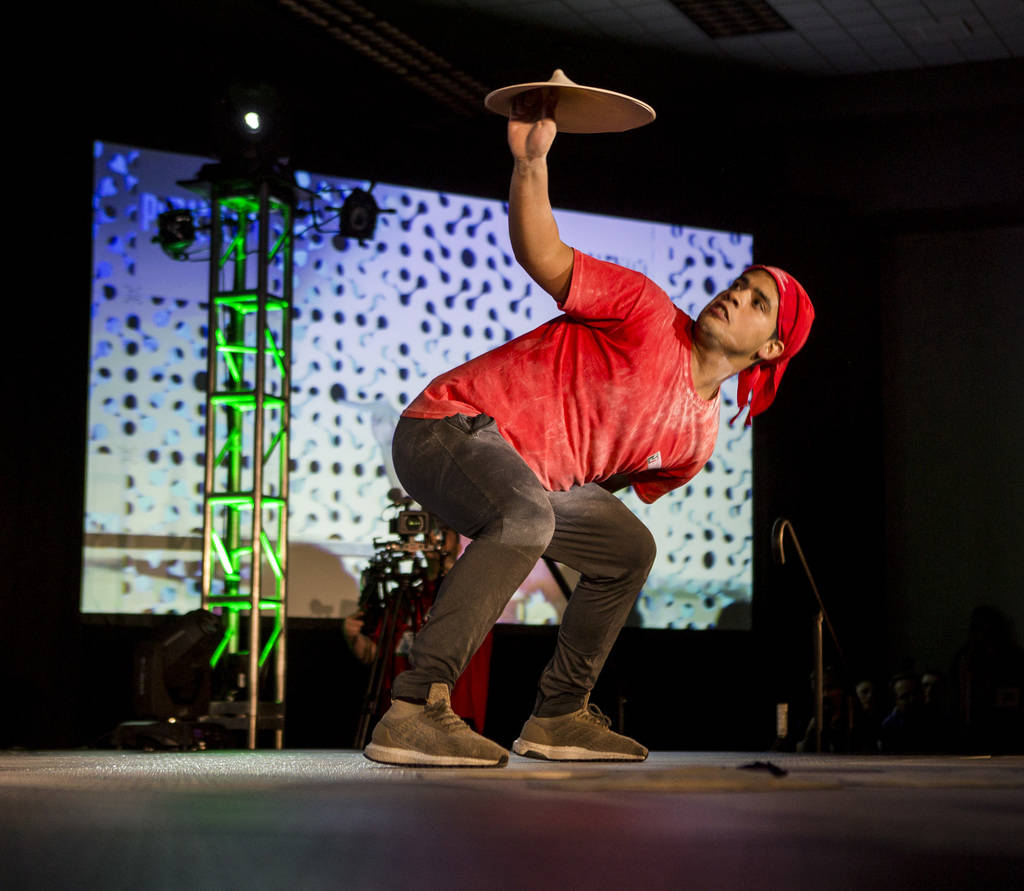 Ezequiel Ortigoza twirls pizza dough behind his back during the freestyle acrobatic dough tossing event of the World Pizza Games at the Las Vegas Convention Center in Las Vegas, Wednesday, March 2 ...