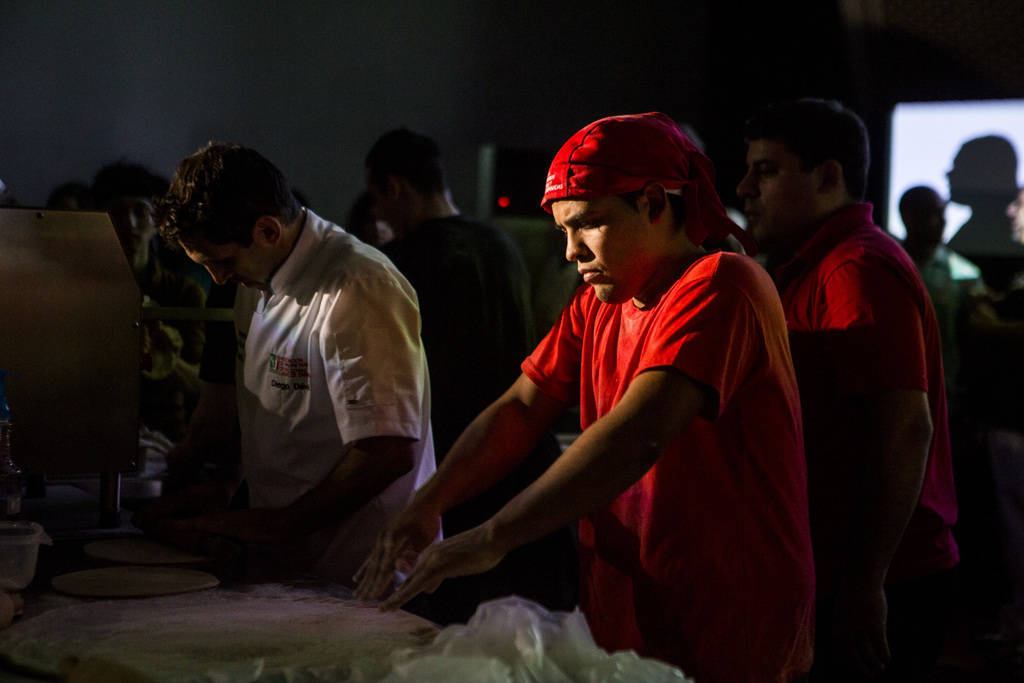 Ezequiel Ortigoza prepares his pizza dough during the freestyle acrobatic dough tossing event of the World Pizza Games at the Las Vegas Convention Center in Las Vegas, Wednesday, March 21, 2018. P ...