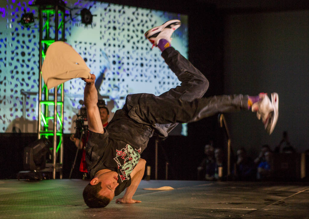 Scott Volpe break dances while holding his pizza dough during the freestyle acrobatic dough tossing event of the World Pizza Games at the Las Vegas Convention Center in Las Vegas, Wednesday, March ...