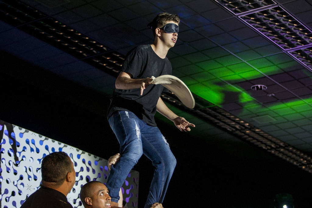 William Gazal Jr. stands blindfolded on the shoulders of his friends while twirling pizza dough during the freestyle acrobatic dough tossing event of the World Pizza Games at the Las Vegas Convent ...