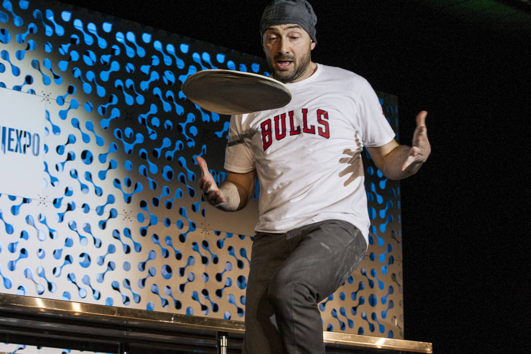 Jerome Falcothrows pizza dough spinning into the air during the freestyle acrobatic dough tossing event of the World Pizza Games at the Las Vegas Convention Center in Las Vegas, Wednesday, M ...