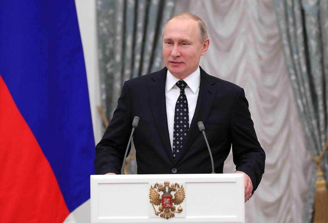 Russian President Vladimir Putin addresses Russian Paralympics Athletes who competed in the 2018 Pyeonchang Winter Paralympics, in the Kremlin in Moscow, Russia, Tuesday, March 20, 2018. (Mikhail  ...