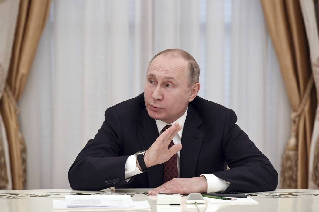 Russian President Vladimir Putin gestures as he speaks during a meeting with opposition candidates who ran against him in yesterday's presidential election, Boris Titov, Maxim Suraykin, Ksenia Sob ...