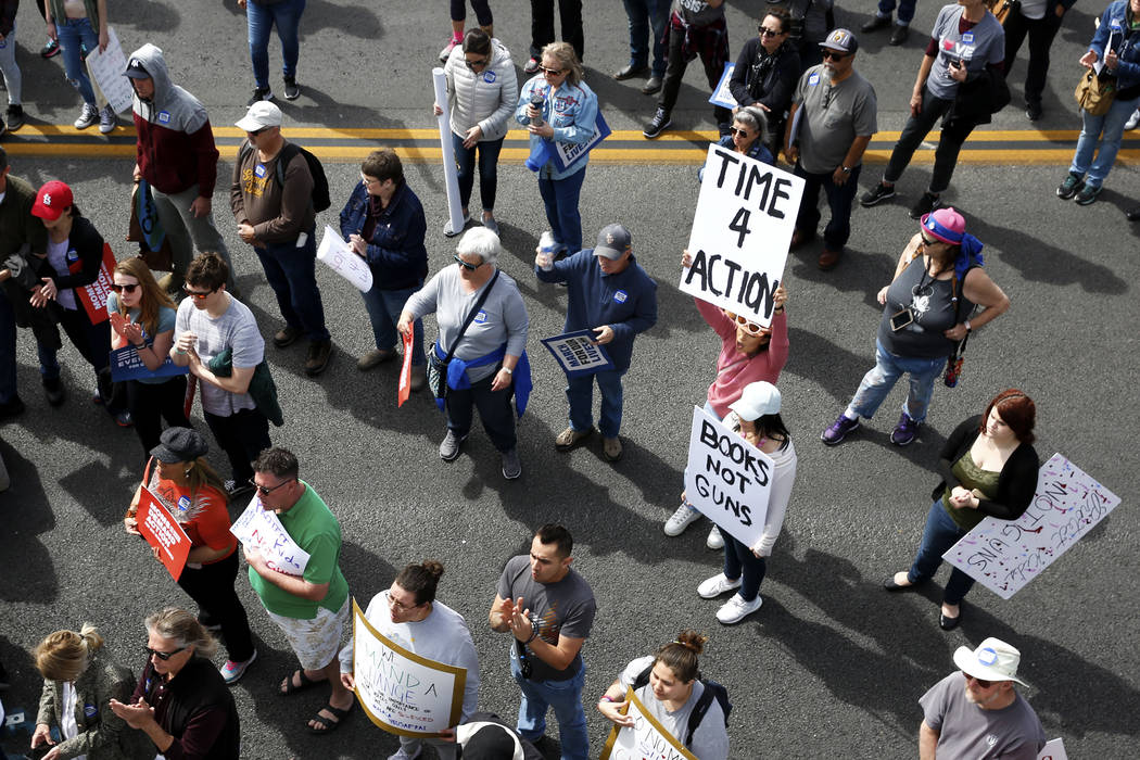 Mercedez Lucero, holding up a sign, and her friend Aileen Chaidez participate in the Las Vegas March for Our Lives event, which started at Symphony Park and ended in Las Vegas City Hall, on Saturd ...