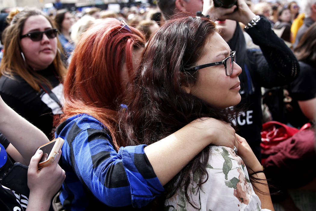 Anna Beajow embraces Francesca Orellana, both 15-year-old students from Green Valley High School, during the Las Vegas March for Our Lives event, which started at Symphony Park and ended in Las Ve ...