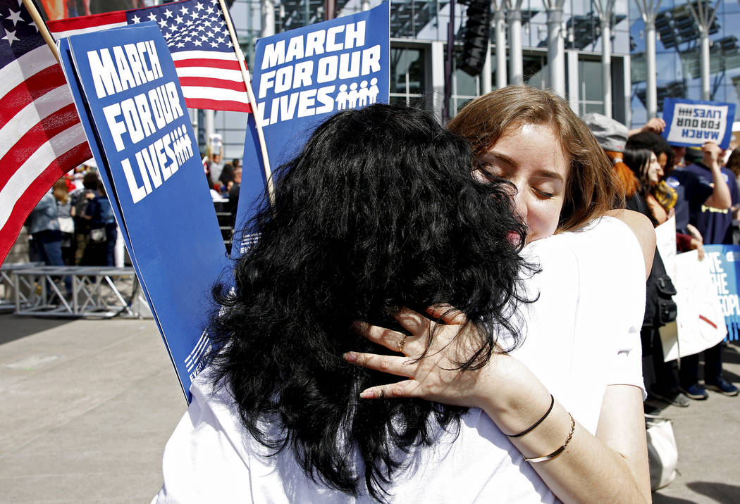 Michelle Vela, a 17-year-old student at Advanced Technologies Academy, embraces her mother Guadalupe Vela following the Las Vegas March for Our Lives event, which started at Symphony Park and ende ...