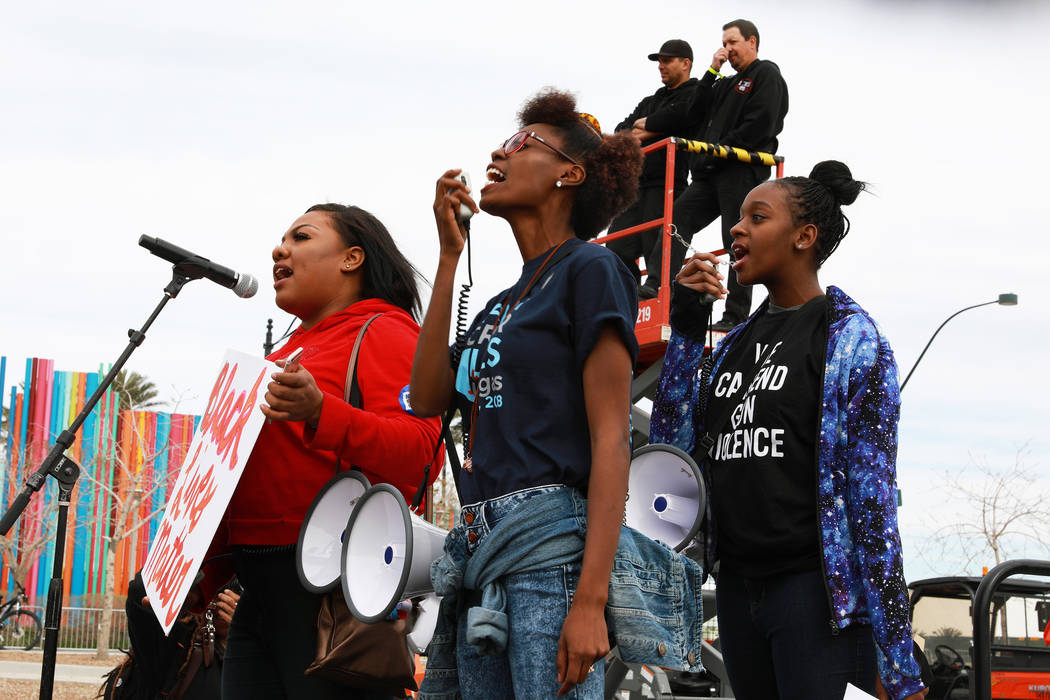 From left, Micajah Daniels, Denise Hooks, and Courtney Jones teach the crowd some chants before the Las Vegas March for Our Lives event, which started at Symphony Park and ended in Las Vegas City  ...