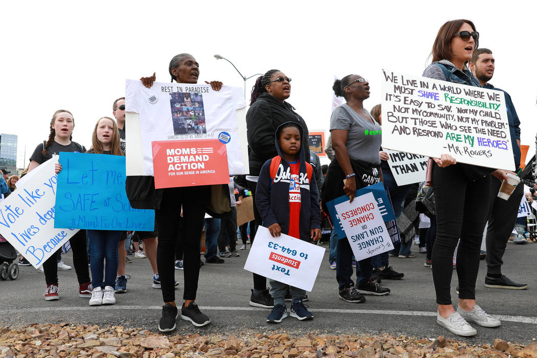 Attendees participate in the Las Vegas March for Our Lives event, which started at Symphony Park and ended in Las Vegas City Hall, on Saturday, March 24, 2018. Andrea Cornejo Las Vegas Review-Jour ...