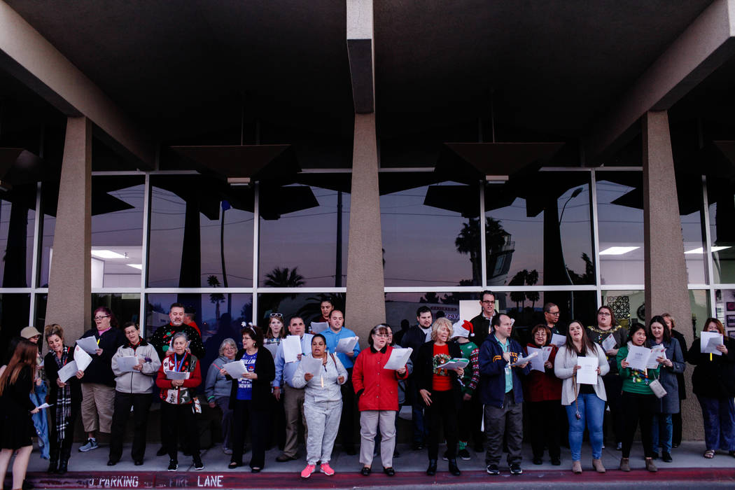 Clark County Education Association teachers protest outside the Edward A. Greer Education Center before a Clark County School District Board of Trustees meeting in Las Vegas, Tuesday, Dec. 5, 2017 ...